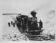 TitleNorthern Pacific Railroad ice bridge over the Missouri River, March 1879   Date of Original1879-03   CreatorHaynes, F. Jay (Frank Jay), 1853-1921  Creator RolePhotographer  DescriptionRailroad locomotive and one passenger car on Northern Pacific Railroad ice bridge over the Missouri River between Mandan and Bismarck. Tracks and ties are laid directly on the ice. Men standing on front of engine, on walkway around passenger car, and on the ice.