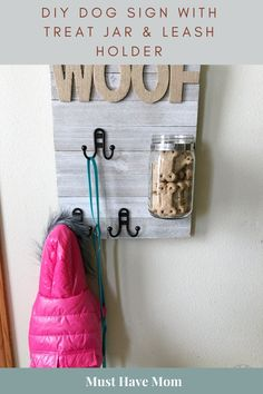 DIY Dog Sign with Treat Jar & Leash Holder. Make this adorable DIY dog leash holder and pet jar and you'll have your dog's supplies at the ready whenever you set out for a walk or need to reward them with a treat! Diy Pet, Diy Dog Bed, Pet Beds Diy, Dog Beds, Dog Crafts, Animal Crafts, Diy Haken, Diy Hooks, Diy Hangers