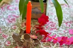 Bright Colour Candles - stuck in sand in mason jars with shells around