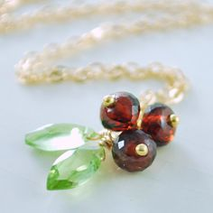 Red Holiday Necklace Genuine Garnet Lime Green Peridot Gemstones Gold Jewelry Christmas Holly Complimentary Shipping. $45.00, via Etsy.