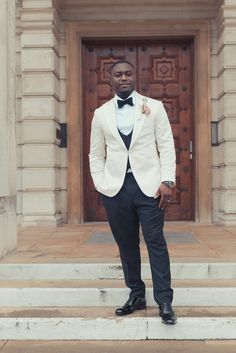 Groom in White Tuxedo with Bowtie At Multicultural Wedding | By James Green Photography | West African Wedding | Traditional African Wedding Outfits | Large Wedding | Fun Wedding | Colourful Wedding | Gold Bridesmaid Dresses | Multicultural Wedding | Groom | Stylish Groom | Wedding Suit | Groom Outfit Ideas Wedding Groom, Wedding Suits, Wedding Fun, Morning Suits, Gold Bridesmaid Dresses, Multicultural Wedding, White Tuxedo, Groomsmen Suits, Looking Dapper