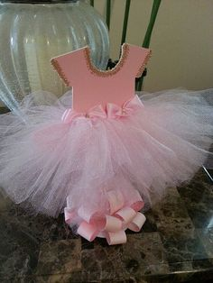 This double-sided pink tutu dress centerpiece will definitely add a beautiful accent to any Ballerina themed party tables. It's made of high-quality cardstock and pink tulle with some pink bows on top. Tutu Centerpieces, Ballerina Centerpiece, Baby Shower Centerpieces, Centrepieces, Ballerina Baby Showers, Baby Shower Princess, Baby Ballerina, Shower Bebe, Baby Boy Shower
