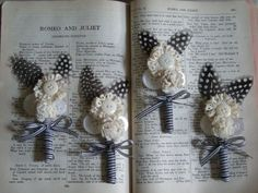 Phil Wickham wedding boutonnières - black and white with feathers and lace and buttons.