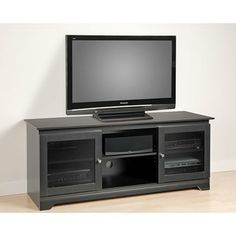 @Overstock.com - Broadway Black Flat-panel Plasma / LCD TV Console - With its classic looks and ample storage, this flat-panel plasma / LCD TV console is perfect for organizing your audio/video components. Designed to accommodate flat-panel TVs up to 150 pounds, this console boasts three generously sized compartments.  http://www.overstock.com/Home-Garden/Broadway-Black-Flat-panel-Plasma-LCD-TV-Console/3723736/product.html?CID=214117 $264.99