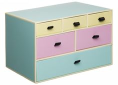 This gorgeous multidrawer storage unit is the perfect way to keep yourself organised whether it be in the office, bedroom or living room! The stylish pastel blue unit has 6 drawers (one large, two medium and three small) each with a different coloured front. The small drawers are pastel yellow with black ribbon handles, the medium drawers are baby pink with black ribbon handles and the large drawer is pastel blue with black ribbon handle. The interior of each drawers is black to match the…