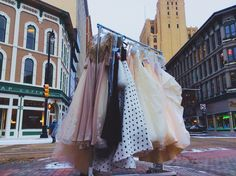 Strolling through the city of Grand Rapids with our dresses....no actually we were racing the dresses across the street for our fashion show at the #GRAM