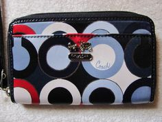 'Coach Madison Blue Multi Sm Wristlet NWT' is going up for auction at  2pm Thu, May 30 with a starting bid of $45.