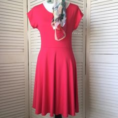 """HP Donna Ricco watermelon colored knit dress Simply gorgeous. Very fine quality heavy knit in a flattering watermelon color. Drapes/hangs beautifully. Perfect amount of stretch. Skater silhouette. Scoop neck, cap sleeves. Hits a couple of inches above the knee on me (I'm 5'7""""). NWT; never worn. Donna Ricco Dresses Midi"""