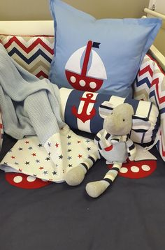 If you're wanting something unique for your Nautical Nursery, this theme combining Red, Blue with a touch of Tan is the perfect theme for any little boy!
