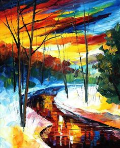 colorful sky over snow, trees, and stream or river
