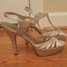 """Silver BLING madden girl strappy stilletos size 10 In excellent condition! Size 10. 5"""" heels. BLING heels, only a couple of jewels missing, can't tell at all unless your looking for it! Only worn a couple of times.   See all pictures for details  Message me if you have any additional questions!   Payment is due within 3 days of auction ending!   Please check out my other listings - I offer great combined shipping rates! Madden Girl Shoes Heels"""