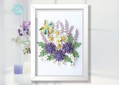 This is an unique framed picture presenting beautiful quilled flowers,which is made by my 8 years old daughter and I.We observe the nature especially different kinds of flowers together, search some good pictures online to make our own paper quilling design.It is really a finicky work
