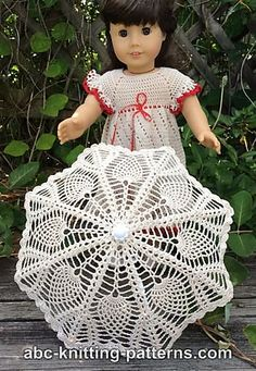 A lace parasol has its place in the wardrobe of any classy young lady, so I thought I would try my hand at making this doll-sized version. I started with a ready-made doll umbrella, from which I removed the fabric. The parasol is crocheted from the center out, like a doily.