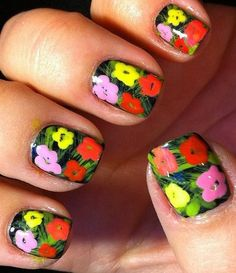 gorgeous floral manicure. Depending on season you can also play around with colour scheme. A light blue background, brown brushstrokes and pink cherry blossom flowers for something more Springy :)