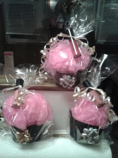 lipgloss mary kay cupcake shower puffs.. great gifts $15 each PM if interested.  I also use these as hostess gifts. :-)
