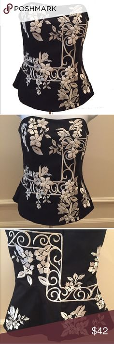 """WHBM Beautiful Embroidered Floral Corset Bustier Let's talk about this item   """"Corset, Floral, Embellished, Embroidered, Bustier, Strapless, Dry Clean Only""""  Size: 0, Color: Black ,White, Material: Rayon; Lining: 100% Cotton,   [Length: 15""""]  [Chest: 14""""]  [Waist: 13""""] [Bottom Hem Width: 16""""] [Note: dimensions are measured in inches. Measurements are recorded when the item is laying flat and is measured across. Numbers need to be doubled if you want the around measurement.]…"""