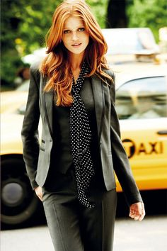 stylish grey suit with a polka dot flair