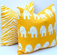 Decorative Pillows Children Decor Bright Yellow Animal Pillow Covers Accent Pillows Nursery Decor 20 x 20 Inches Elephant and Zebra Prints. $34.00, via Etsy.