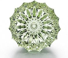 125.0 ct. spirographic cut mint green Beryl with a concave pavilion and flat faceted crown by Dalan Hargrave Stephanie Michael Young receiving 1st place Cutting Edge Agta Award 2005