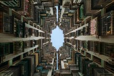 NOVEMBER 23, 2016 CLEAR VIEW Your Shot photographer Peter Stewart offers a dizzying view of an apartment block in Macau, China. Though quarters may feel close—and perhaps a little chaotic—down below, a look up reveals a bright, clear sky framed within the tidy symmetry of the buildings' rooflines. PHOTOGRAPH BY PETER STEWART, NATIONAL GEOGRAPHIC YOUR SHOT
