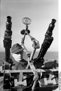German gunner handling two MG ( 34?) used as FLAK ( anti-aircraft ). North France  October 1943
