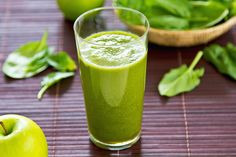 This delightfully green smoothie is perfect for getting kids to eat their vegetables! Spinach, green grapes, banana and green apple combine with natural yogurt and a dash of vanilla. #Green #Apple #Spinach #Smoothie