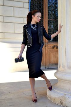 Long teacup length dress with black leather jacket and black statement necklace.