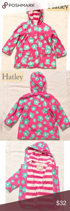 HATLEY Pink Floral Raincoat Sz. 2 PRODUCT INFORMATION: Rainy days can stay as long as she's got this awesome Hatley™ Kids raincoat! Cozy terry lining provides warmth on chilly days. Attached hood. Long sleeve design. Full snap front. Front pockets with snap-flap closure. Inner identification label at back. Straight hemline. Fully lined. 100% polyurethane; Lining: 100% polyester. Machine wash cold, hang dry. Imported. Hatley Jackets & Coats Raincoats