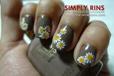 Gray nails with daisies.  Cute!