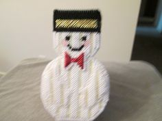 Snowman Covered Basket in plastic canvas by CraftsforSalebyJune