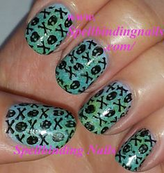 Skulls and Crosses  - http://www.spellbindingnails.com/2012/07/vivid-lacquer-image-plates-manicure.html