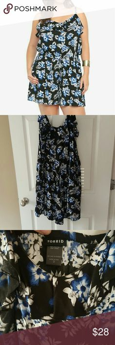 Torrid Floral Romper Torrid! Size 3! Fun flirty floral romper. Worn once on my vacation to Disney World. Cute ruffle neckline. Spaghetti straps that are adjustable. Perfect condition. Black & blue color scheme. Draw string helps define waist & camouflage any 'problem areas'. Flowy leg openings. Super light and breathable. torrid Pants Jumpsuits & Rompers