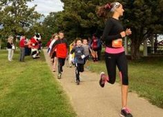 McKenzie Howbert, 14, leads the way during a kids fun run Saturday morning at the YWCA, 225 S.W. 12th. The run was part of the sixth annual ...