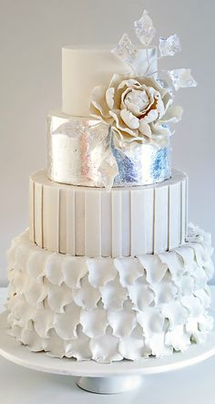 Unique wedding cake: all white with silver bling.
