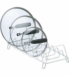 Organize the lids from all of your pots and pans with this Wire Lid Storage Rack the perfect accessory for every kitchen. Pot Lid Storage, Wire Storage Racks, Pot Lid Organization, Lid Organizer, Kitchen Cabinet Organization, Kitchen Storage, Storage Spaces, Organizing Ideas, Cabinet Organizers