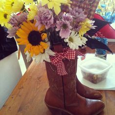 The cowgirl bouquet I made for my sister. Sunflowers, daises, purples, cowgirl boots, yellows, whites. Perfect gift for graduation, birthdays ext. Cowgirl Chic, Cowboy And Cowgirl, Cowgirl Boots, Graduation Gifts, Sunflowers, Interior Decorating, Birthdays, Bouquet, Future