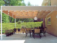 ShadeTree Retractable Canopy Systems are an attractive way to shade your deck or patio. Awning Shade, Patio Shade, Deck Awnings, Outdoor Plants, Outdoor Decor, Shade Umbrellas, Aluminum Decking, Deck Canopy, Retractable Pergola