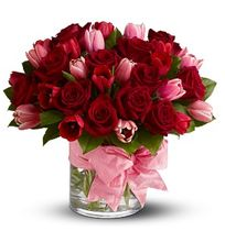 """P.S. I Love You.  Tell someone, """"I love you!"""" with two of nature's most beautiful blooms – fragrant crimson roses for romance, and delicate pink tulips to signify friendship and devotion.  Reseda Florist, Allen's Flower Market Reseda.  http://www.allensflowermarketonline.com/p-s-i-love-you/"""