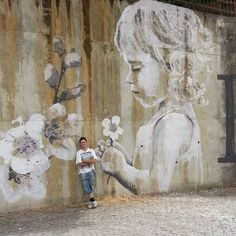 Little girl on a mural by spanish street artist sfhir #streetart