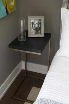 Sleek+and+simple,+this+modern+bedside+table+serves+as+a+convenient+nightstand+for+guests.