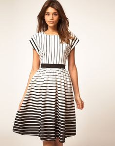 This style dress along with the placement of the stripes is how you make lines work with your body.  A belt is a sure way to define the waist and create the classic silhouette.