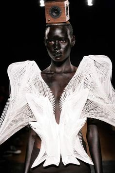 """Wearable Art, """"London architect Daniel Widrig has collaborated with fashion designer Iris van Herpen and digital manufacturers .MGX by Materialise to create a collection of digitally printed clothing"""" narrative from website, headdress is by Stephen Jones"""