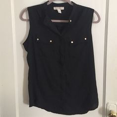 Classic black blouse Black button down. Sleeveless. Two front pockets cute buttons. Never worn Forever 21 Tops Blouses