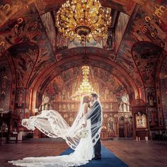 """The Wed List on Instagram: """"Breathtaking wedding venue that catches our hearts! The combination of wooden floor, high ceiling and gold chandeliers creates a grandeur ambience. We also love how the intricate wall painting details injected a phenomenal end note to the place! Isn't this St. Nicholas Serbian Orthodox Church absolutely romantic? Tag someone who would love this! Photography by AGI Studio / Dress by @galialahav @whitetoronto via @meisamrms"""""""