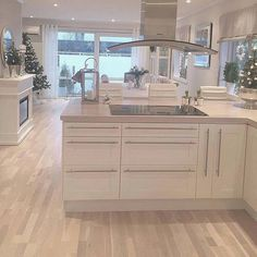 Clean white units but I would have darker wood flooring