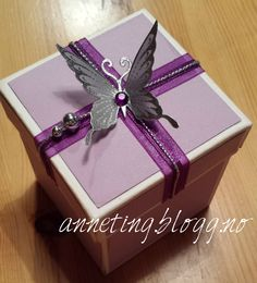 purple explotionbox with silver butterfly