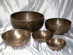 "Jambati, (Tibetan), large, average size 11'diameter x 6""tall , transcendent wisdom & grounding. Average price $500-$700 (far back)  Jambati, (Tibetan), average size, 9.25"" diameter x 4.25"" tall ... transcendent wisdom. Average price, 410.00 - $480 (back right)  Larger Minipuri Heart Bowls, average size of 8"" diameter x 3."" tall, price range $250-$325 (left)"