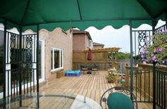 """""""The Oakville"""" double level deck,arbor,flower pots, """"safe-t"""" railing, by Normoe, the Backyard Guy. *Look at the matching lines for both decks"""""""