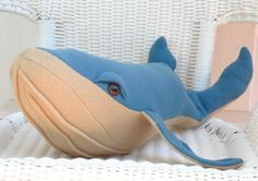 Big whale plushie measures 26 inches long and 6 inches in height. Taken from a wonderful pattern by Crafty Kooka , this whale is made from a teal and tan colored fleece fabric to make it extra soft and cuddly. The hooded eyes are made from 20mm child safety eyes and add personality to the whale. A wonderful addition to a whimsical touch for a nautical decor or for any child who loves ocean life creatures