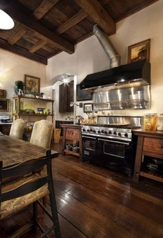 Great mix of modern and antique with zero built-ins. Fabulous floor, black Vicking and eat-in farm table.